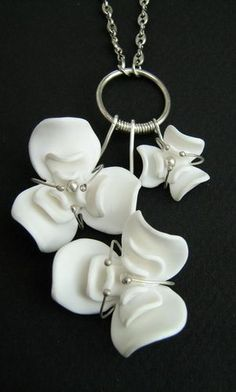 Piece of jewelry made from wire and polymer clay.