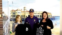 Ocean City Home Bank donates to Coffee Express program Tricia Ciliberto, left, and Bernadette Gizelbach, right, of Ocean City Home Bank, present Walk for the Wounded shirts to John Laughlin, chairman of the American Legion's Coffee Express committee.