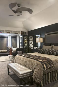 This large remodeled bedroom got a complete gut. In addition to the black painted wall, did you notice that silver ceiling fan? Repin if you'd love to have a similar design in your home.