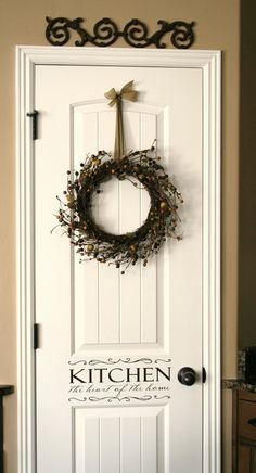 "great idea for pantry door. Love the wreath and the ""kitchen wall art"""