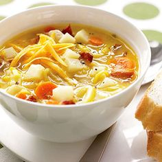With their mild onion flavor, leeks are a delicious addition to this potato soup recipe. Bits of bacon, chunks of carrot, and shredded cheddar cheese make the soup taste like a baked potato with all the fixings.