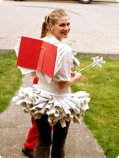 The book fairy? Oh my! someone just has to help me and make me one of these. Only problem is dress code says those pages in that skirt have to go to my knees. I guess we could just do layers. Heck, you all know how short I am.