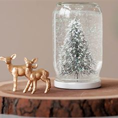 Make your own snow globes using old jars!