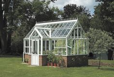 Suddenly, I want a greenhouse! Love this Villa Greenhouse Design by Hartley Botanic