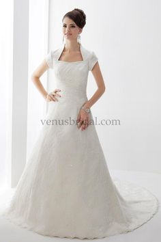 The queen anne neckline makes this modest wedding gown stand out!