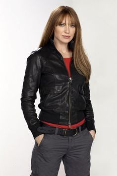 Promo photo for Alternate Agent Olivia Dunham in the FRINGE Season Three. Love the red hair and bangs!