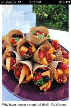 Fresh fruit served in a waffle cone. I would top with some Reddi Whip.