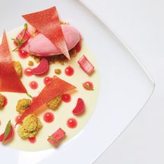 Oceana's white chocolate and tarragon ganache with rhubarb ice cream, poached rhubarb and pistachio streusel.