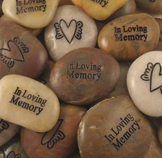 """Hand these memory stones out at the celebration of life. One side says """"In Loving Memory"""" and the other side has a sweet picture of a heart with wings. When friends and family come across the stone they will remember your loved one. #memorial gift, #funeral gift, #memorial service ideas, #creative funeral ideas."""