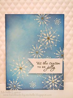 handmade card ... emboss/resist ... white snowflakes ... blues sponged on and around ... beautiful!!