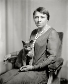 """America's first woman Senator was from Arkansas! circa 1925. """"Mrs. Thaddeus Caraway and cat."""" The cat's accomplishments are lost to history, but Hattie Caraway went on to become a two-term U.S. Senator, the first woman ever elected to that office."""