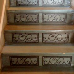 Antique blue stairs with wrought iron pieces from walmart. Very inexpensive but to die for look and they are mine. Such small things make me so happy !