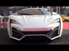VIDEO:    Revealed at this year'sDubai International Boat Show, the Lykan HyperSport 2013 (fromW Motors) is the world's most expensive car absurdly priced at $3.4 million dollars.Only 7 will be made, all manufactured in Dubai — the first Arabian supercar (is it also the first Arabian car of any type?)•mid-engine twin turbo flat-six (built by RUF)•750 HP.•100 km/h in just 2.8 seconds• Top speed 395 km/h.• Only 7 units to ever be made.•$3.4 million USD.