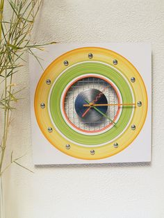 Hand-painted modern wall clock in cactus green, bamboo yellow and peach