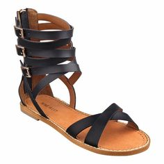 """A trio of golden buckles lights up our Gladis strappy gladiator sandals that flaunt a certain flirty, feminine flair. Back zip for easy on/off. Leather upper. Man-made lining and sole. Imported. 1/4"""" low heels."""