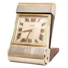 CARTIER Gold, Silver and Leather Travel Clock | From a unique collection of vintage  at http://www.1stdibs.com/jewelry///
