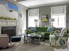 "It's all about sound in the family room—it's the space where you watch movies or shows or listen to music. Designer Christina Murphy used Phillip Jeffries Manila Hemp grass cloth on this New York apartment's wall to make it work with the family's activities. ""This where the family watches TV, and the paper works to absorb sound in a way that's cozy,"" Murphy says."