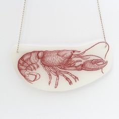 Step-by-step photo tutorial for making jewelry from shrinky dink plastic with vintage images like this lobster. Includes links to
