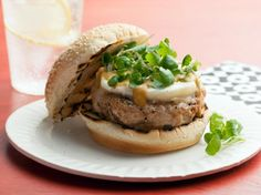 Bobby Flay's Top Recipes Turkey Burgers:  Add big flavor to these burgers by topping them with goat cheese, lemon-honey mustard, and watercress.