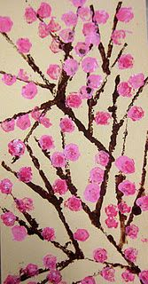 cherry blossoms, so sweet - straight edge like cardboard for branches, balled up paper for blooms