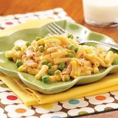Cheesy Tuna Mac:         1 package (7-1/2 ounces) macaroni and cheese            mix  1/2 cup 2% milk  1 tablespoon butter  1 can (10-3/4 ounces) condensed cream of broccoli soup, undiluted  1 can (6 ounces) tuna, drained and flaked  3/4 cup frozen peas  2 tablespoons finely chopped onion  1 tablespoon process cheese sauce