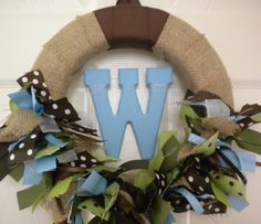 burlap baby ribbon wreath in greens, brown, and blues