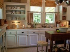 love this farmhouse looking kitchen!