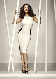 Salma Hayek curves in a black and white body con dress and high heels