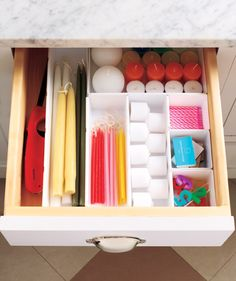 LOVE the idea of a candle drawer! Have several different types of one thing? Create an all-of-a-kind drawer to keep everything organized.