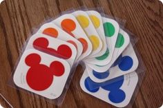 "Paint chips. *I use pairs of these to pair up my students in class. They draw them out of a bag, find their match & then work together. I let the ""true Mickey Mouse"" ears (black pairs) get first pick of materials or place to sit."