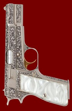 Pearl handled, nickel plated, and etched Browning hi power with a goldplated trigger