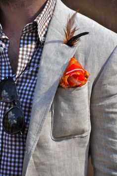 Feather in lapel button hole