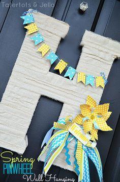 #Spring Pinwheel Door Hanging @tatertotsandjello.com wall hangings, pinwheel door, door hangings, pinwheel wall, front doors, wreath, banner, baby showers, spring pinwheel