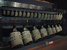 "Bell Set.  Spring and Autumn Period.  Henan Provincial Museum, Zhengzhou.  According to their inscription, this set of bronze bells was ""made by Wang Sunhao to greet the Chu Emperor."""