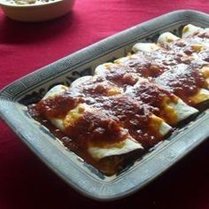 tomato sauce is simmered with sauteed onion, salsa, and herbs, including cumin and oregano. this is good with cheese-stuffed, baked tortillas.