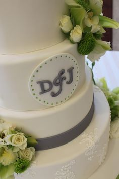 Use colored flowers to accent a gray and white wedding cake. #grayweddings #weddingcake