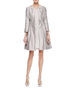 How nice is this? It's a Spring's gray, feels buoyant and light, not rich and warm (Autumn). The dress beneath may well be Light Spring's, while the silver of the coat can shift the same colour up to Bright Spring. Doesn't matter. Gray is very adaptive.