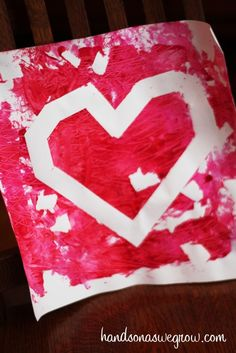 Tape resist toddler art for Valentine's Day -- fun ways for a toddler to paint!