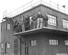 US 401st Bomb Group's control tower at Deenethorpe, Northamptonshire, England, Feb 26 1945. Note a US Navy Captain among the observers. (US National Archives)