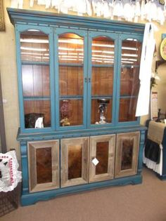 $398 - This rustic hutch has great western flare with real cowhide inlaid in the doors, painted turquoise on the exterior and wood tone interior!  ***** In Booth D8 at Main Street Antique Mall 7260 E Main St (east of Power RD on MAIN STREET) Mesa Az 85207 **** Open 7 days a week 10:00AM-5:30PM **** Call for more information 480 924 1122 **** We Accept cash, debit, VISA, MasterCard or Discover.