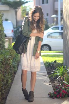 Utility jacket, white dress, gray ankle boots. Keep dress hemline above knee to create the longest leg line possible.
