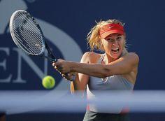 Tennis. Maria Sharapova of Russia hits a return to Alexandra Dulgheru of Romania during their match at the 2014 U.S. Open tennis tournament in New York, August 27, 2014. (Photo by Eduardo Munoz/Reuters)