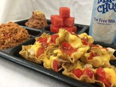 Chicken Nachos with Mexican Rice made with Cheese Sauce Instant Mix (088T) and Mexican Rice Seasoning Mix (V419)