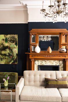 Dark blue, green, and white living room.  Velvet.  Wood fireplace.