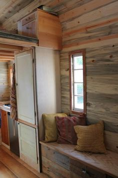 aprils tiny house-sofa on other side of kitchen leaves a big open nook for a desk on the side of the door.