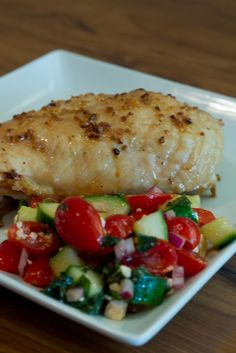 """Garlic Chicken and Cucumber Salad... Very yummy, healthy and refreshing. I only did two chicken breasts and still kept the sauce the same. As for the salad I keeps the """" dressing"""" measurements the same and just did one cucumber and eye balled my other veggies/ feta to what looked good... But very easy and yummy"""