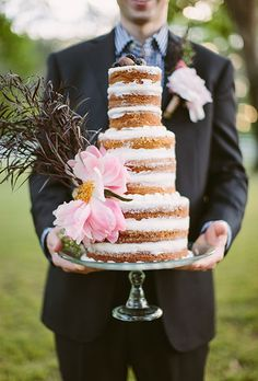 A lovely, three-tier naked wedding cake.