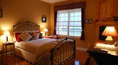 Buchanan - This room is furnished with antiques, hand made furniture and authentic Buchanan tartan. Enjoy a magnificent view of the Smoky Mountains as you relax in front of the fire.