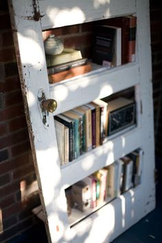 Old door to a bookshelf.