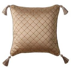 "Pillow with tasseled corners and a trellis motif accented by rope-twist edging.   Product: PillowConstruction Material: 55% Polyester and 45% cotton cover and polyester fillColor: Pale goldFeatures:  Insert includedZipper closure Dimensions: 18"" x 18""Cleaning and Care: Spot clean only. Dry cleaning recommended."
